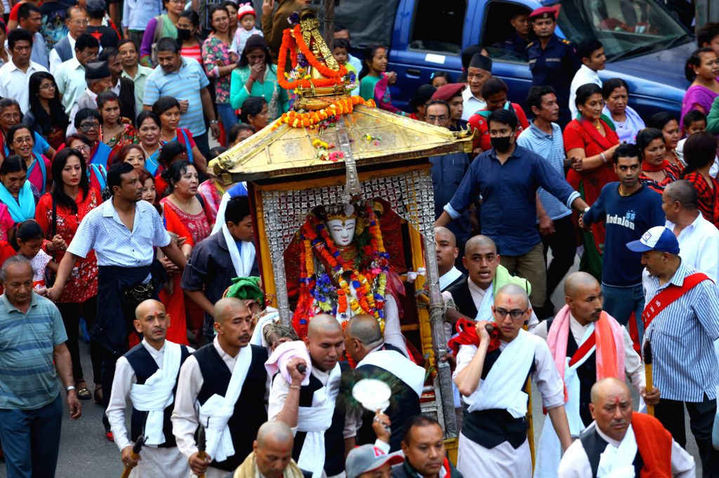 KATHMANDU, April 15, 2016 - People carry a palanquin with an idol of Seto Machhendranath from a temple to a chariot during a procession to mark the beginning of Seto Machhendranath Chariot festival ...