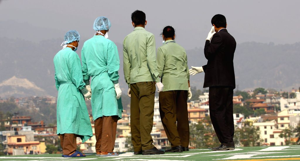 Doctors wait for the arrival of the injured people from the avalanche near the helipad at Grandi International Hospital in Kathmandu, Nepal, April 18, 2014. An ..