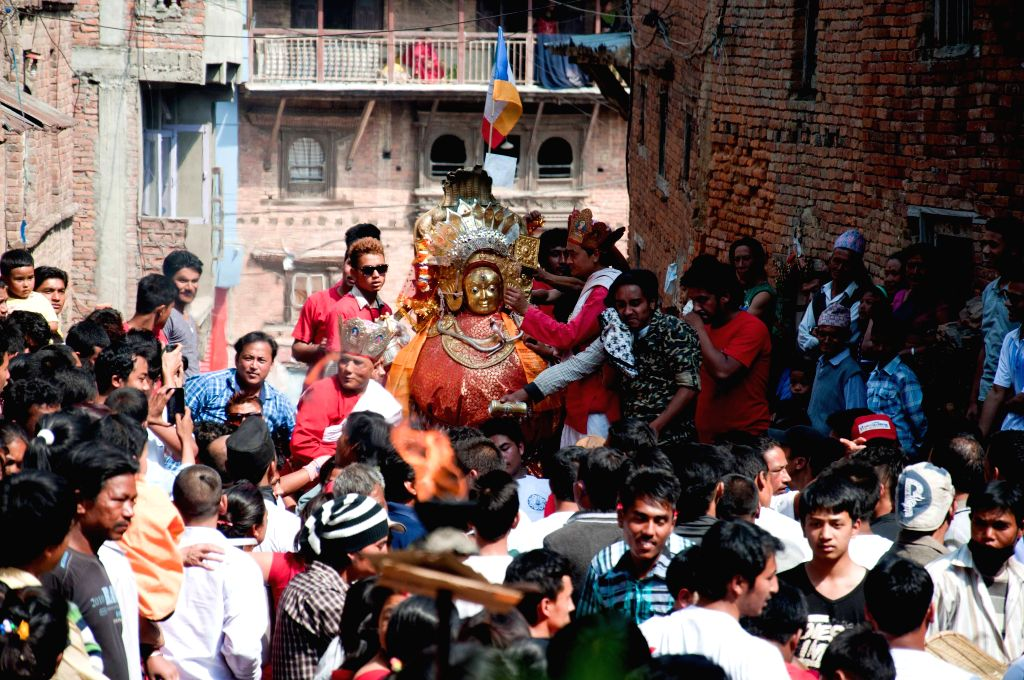 Locals carry a palanquin with the idol of Bajrayogini during the Bajrayogini festival, a significant festival of Sankhu, on the outskirts of Kathmandu, Nepal, ...
