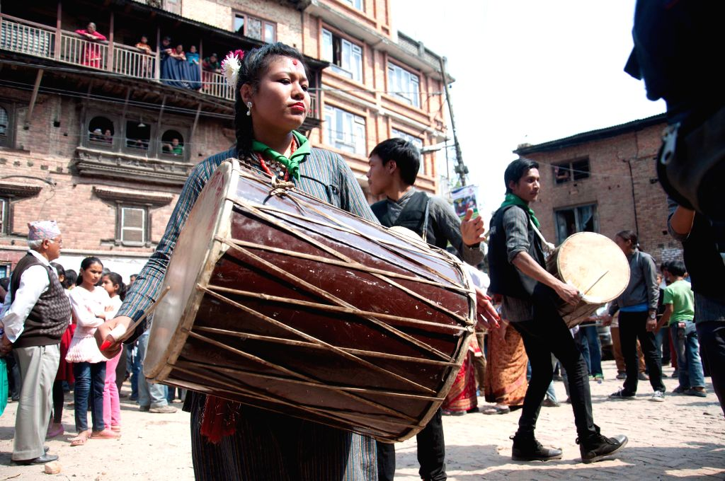 Locals play musical instruments during the procession of Bajrayogini festival, a significant festival of Sankhu, on the outskirts of Kathmandu, Nepal, April 18, .