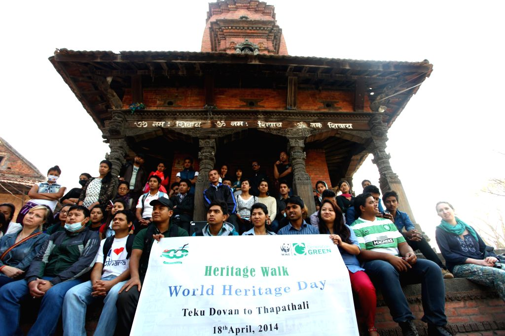 Nepalese youth participate in a heritage walk organized to mark the World Heritage Day in Kathmandu, Nepal, April 18, 2014.  ...