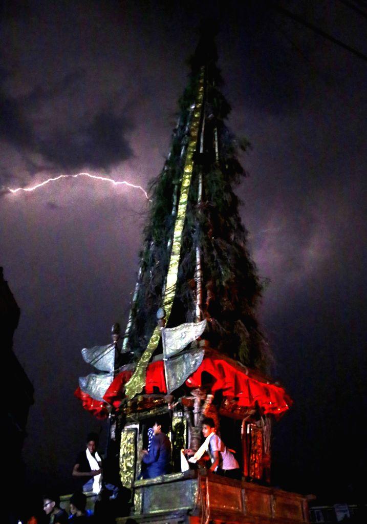 KATHMANDU, April 19, 2016 - Lightning strikes to the side of chariot of Seto Machhendranath on the last day of Seto Machhendranath chariot festival at Lagan in Kathmandu, Nepal, April 18, 2016. Seto ...