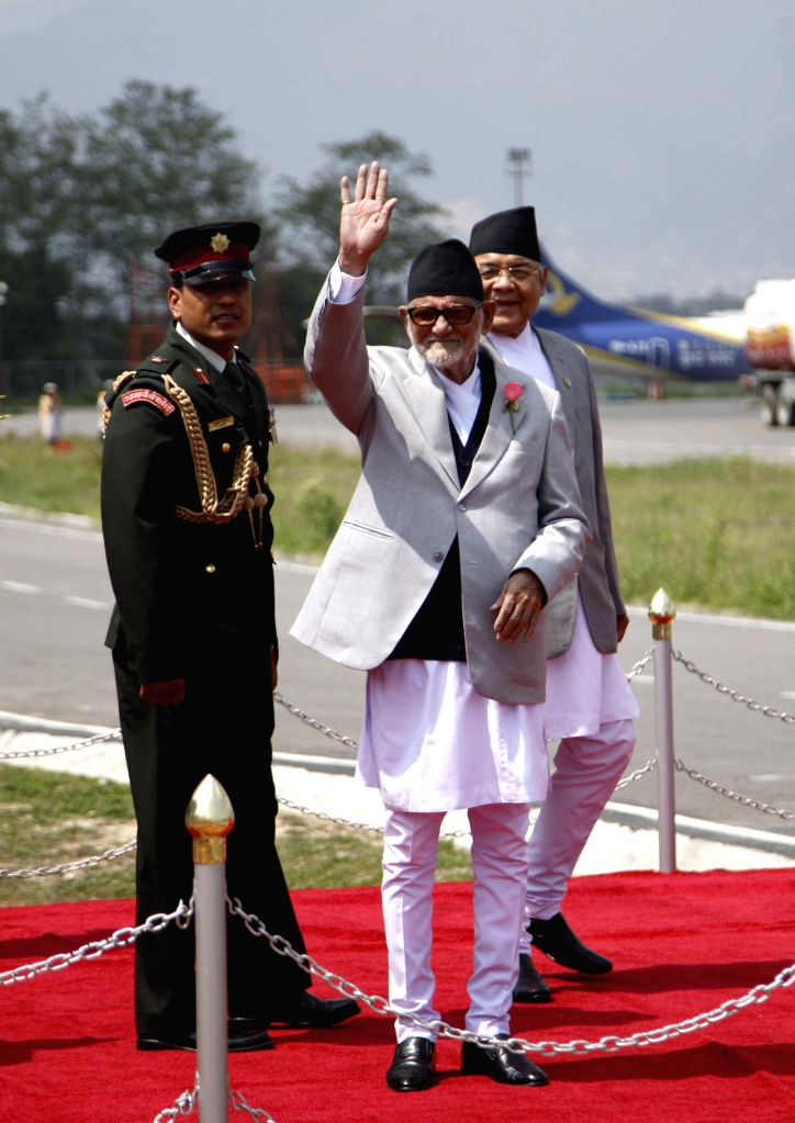 Nepali Prime Minister Sushil Koirala (front) gestures before leaving for Indonesia to take part in the commemorations of the 60th anniversary of Bangdung ... - Sushil Koirala