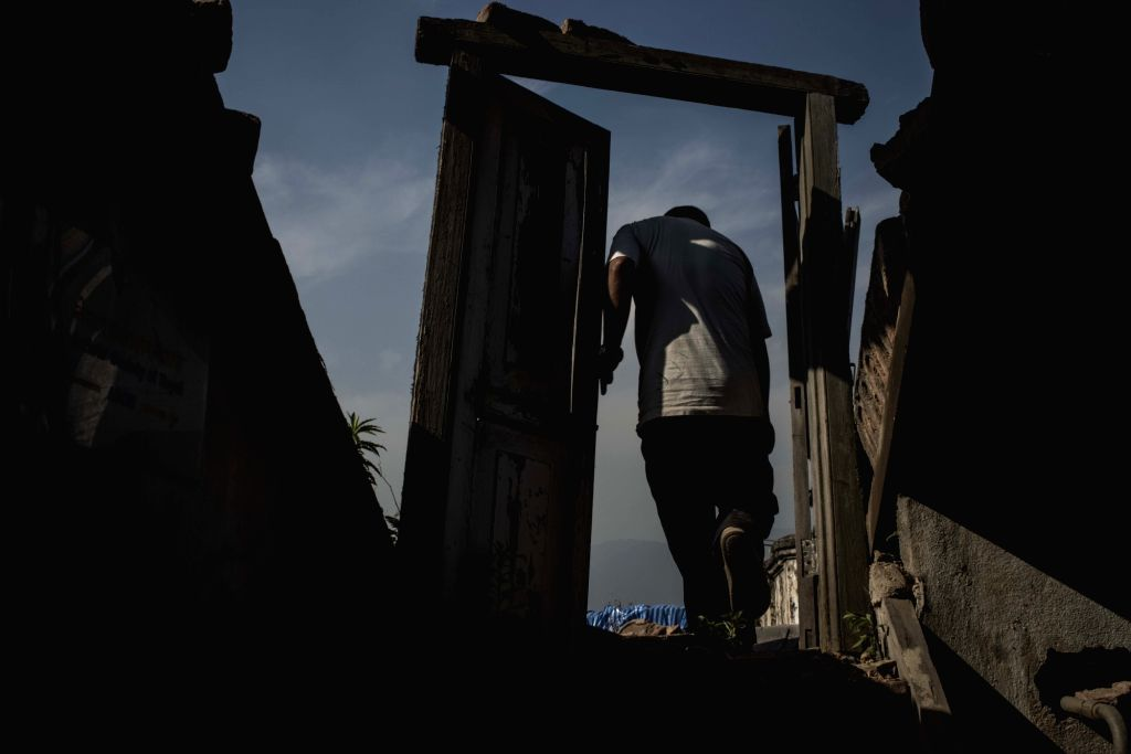 KATHMANDU, April 23, 2016 - Photo taken on Aprril 22, 2016 shows a man walking past ruins of the Pal Mandil Orphanage which was damaged during the April 2015 earthquake in Kathmandu, Nepal.