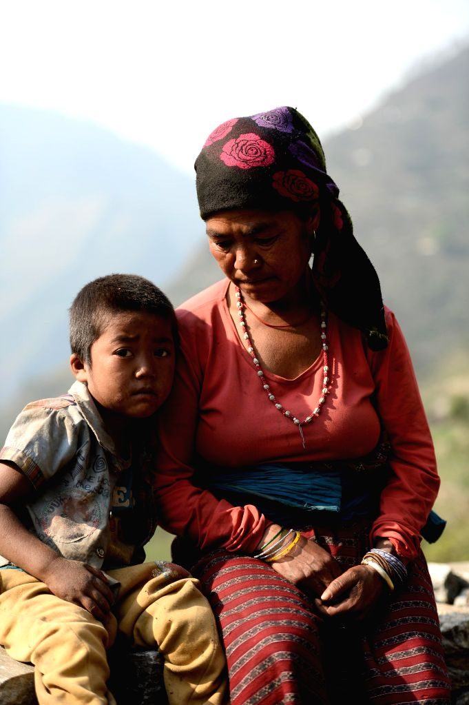 KATHMANDU, April 24, 2016 - Earthquake orphan Suraj Tham sits with his grandma at Thami village on Mt. Tatopani, Nepal, on April 22, 2016. Suraj Tham lost his mother and younger brother in the ...