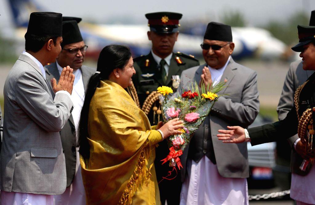 KATHMANDU, April 24, 2019 - Nepali President Bidya Devi Bhandari (3rd L) is bid farewell by Prime Minister KP Sharma Oli (5th L) as she leaves for a visit to China at Tribhuvan International Airport ... - K