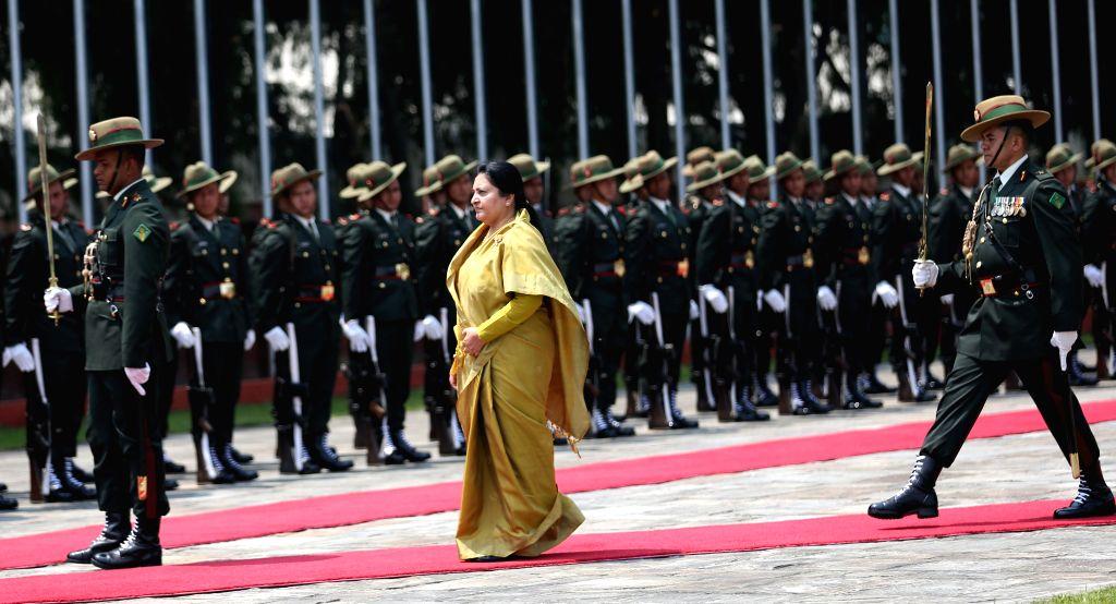 KATHMANDU, April 24, 2019 - Nepali President Bidya Devi Bhandari reviews the honor guard as she leaves for a visit to China at Tribhuvan International Airport in Kathmandu, capital of Nepal, April ...