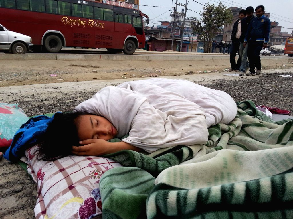 A little girl sleeps on road side in Kathmandu, Nepal, April 26, 2015. Death toll from Nepal earthquake surpasses 1,800, and over 4,700 people were injured, Home ...