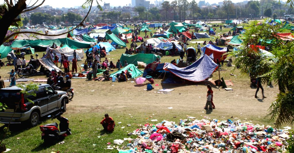 People take shelter in tents after a massive earthquake at Tudikhel in Kathmandu, Nepal, April 27, 2015. A total of 3,218 people had been killed and about 6,500 ...