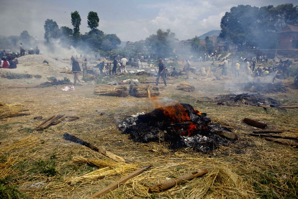 Photo taken on April 26, 2015 shows bodies of victims cremated in Bhaktapur, Nepal. A total of 3,218 people had been killed and about 6,500 others injured in the ...