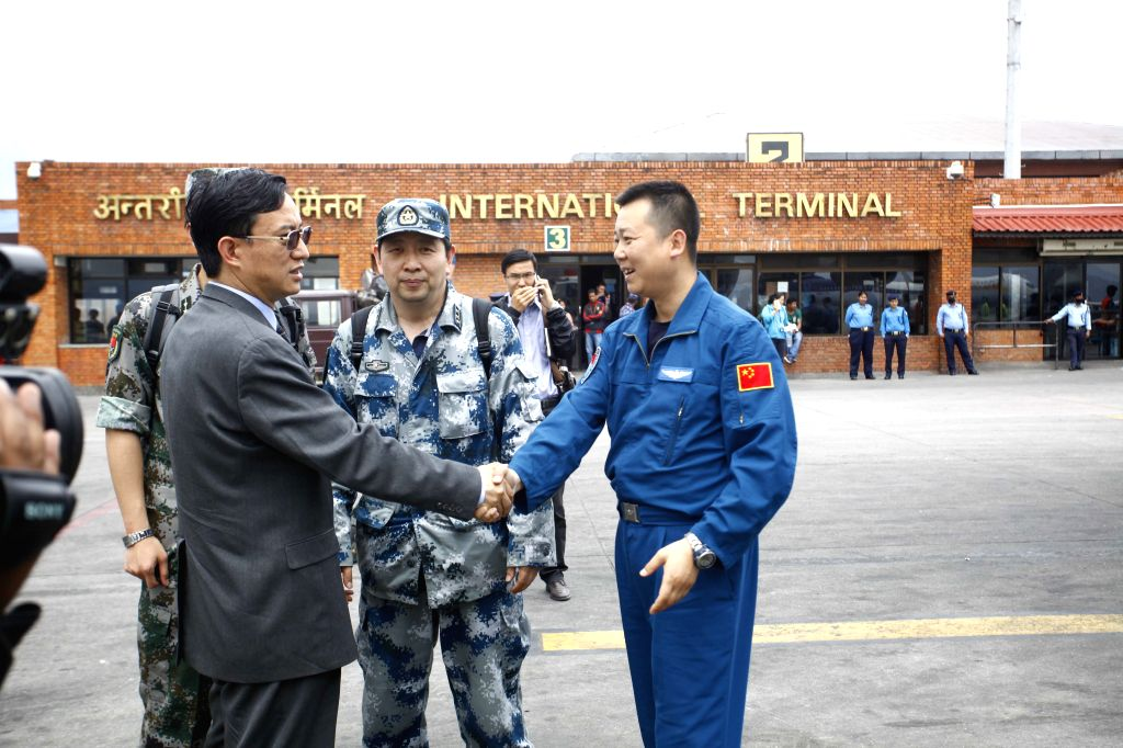 Chinese Ambassador to Nepal Wu Chuntai (L, front) welcomes members of Chinese People's Liberation Army Air Force at Tribhuvan International Airport in Kathmandu, ...