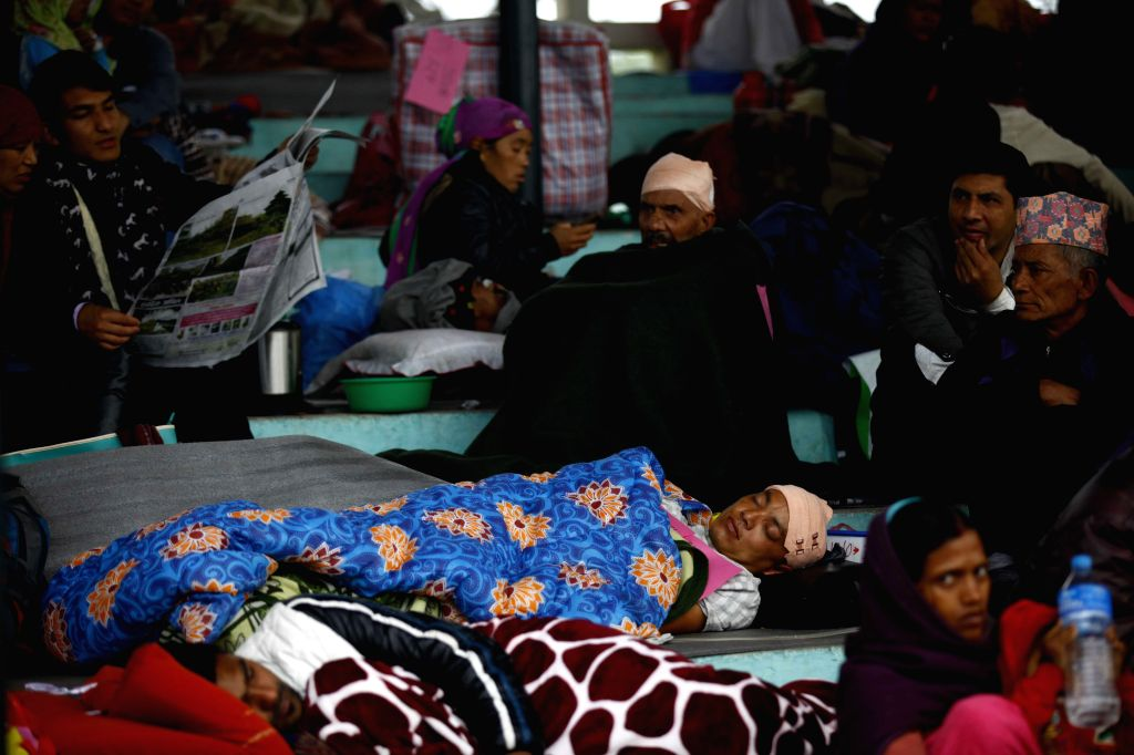 People take shelter at an army pavilion in Tundikhel, Kathmandu, Nepal, April 28, 2015. The death toll from a powerful earthquake in Nepal has risen to over ...