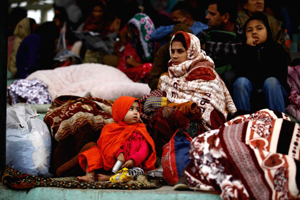 People take shelter at the Army Pavilion in Tundikhel, Kathmandu, Nepal, April 28, 2015. The death toll from a powerful earthquake in Nepal has risen to 5,057, ...