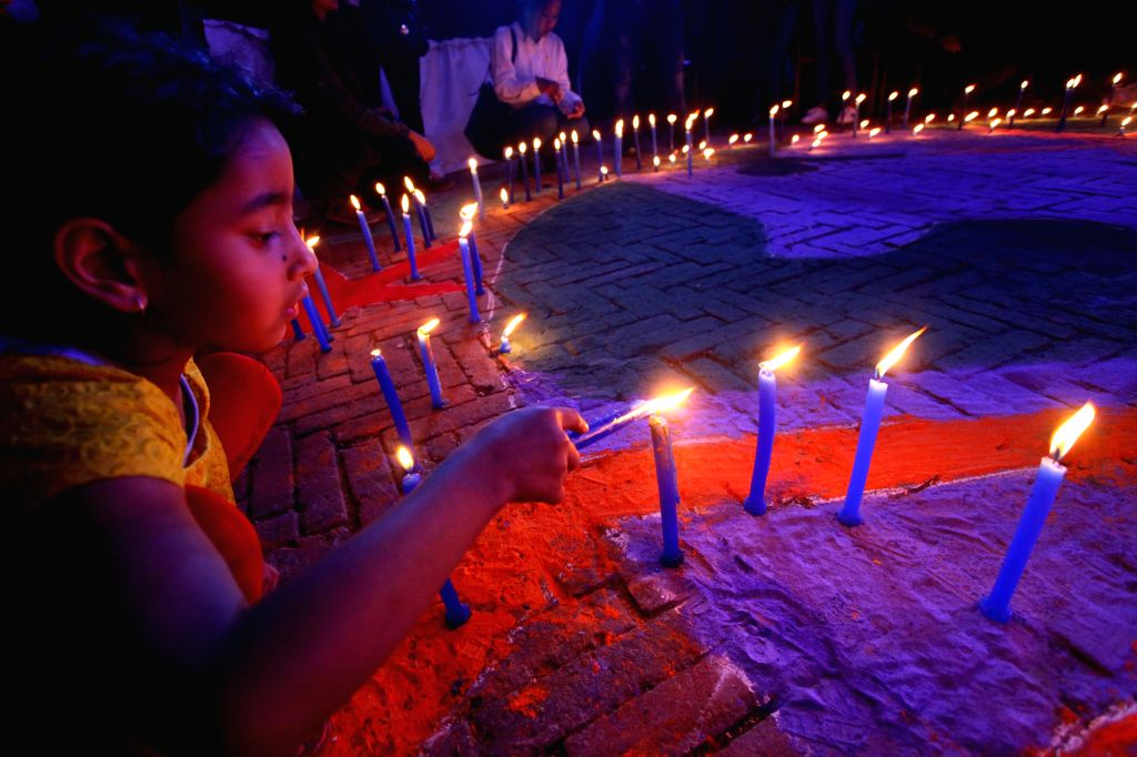 KATHMANDU, April 4, 2018 - People light up candles during an event to call for care for autistic children to mark the World Autism Awareness Day in Kathmandu, Nepal, April 3, 2018. The World Autism ...