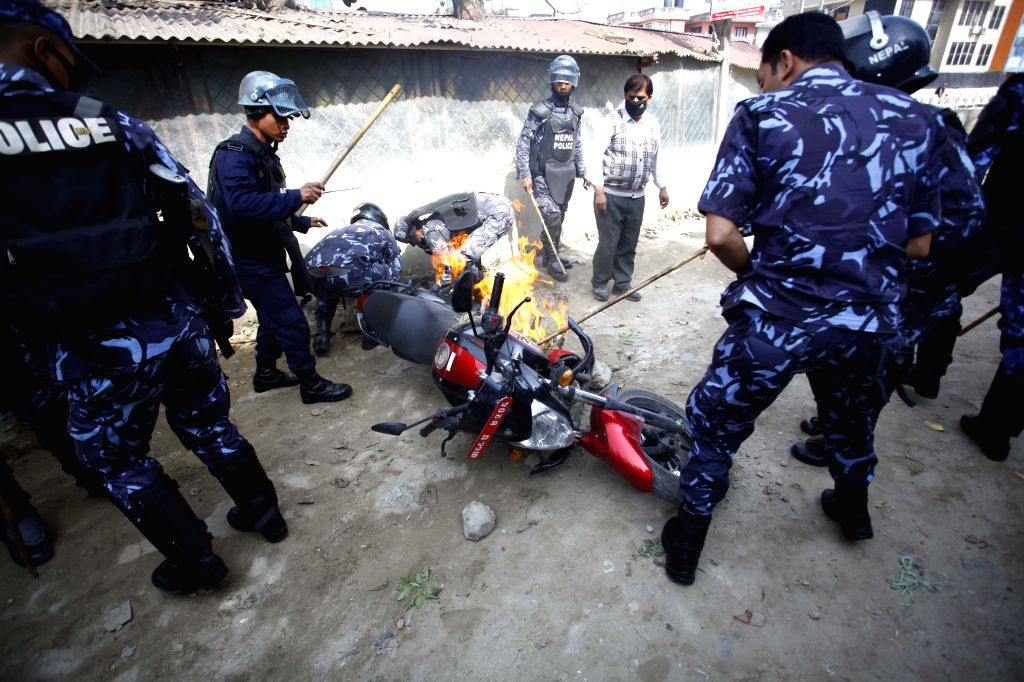 Demonstrators fire a motorbike during a strike called by the UCPN (Maoist)-led 30-party alliance Kathmandu, Nepal, April 7, 2015. The disgruntled opposition ...