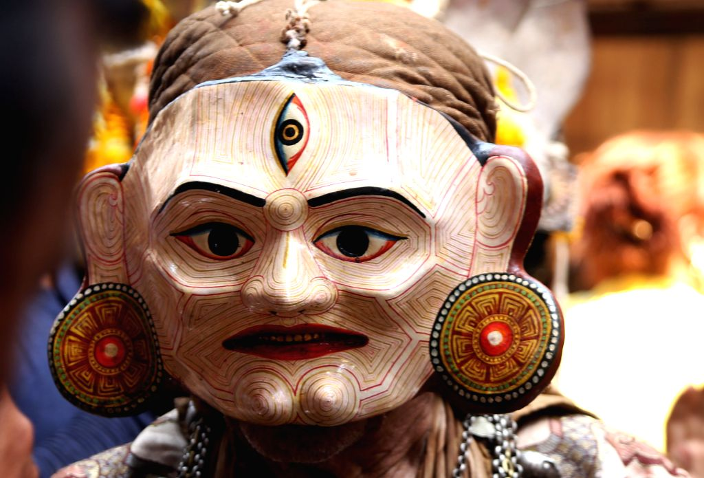 "KATHMANDU, April 7, 2016 - A masked dancer dressed up as deity arrives to perform ""Devi Pyankha"" (Devi Dance in local language) to mark the Ghode Jatra (horse racing festival) in Kathmandu, ..."