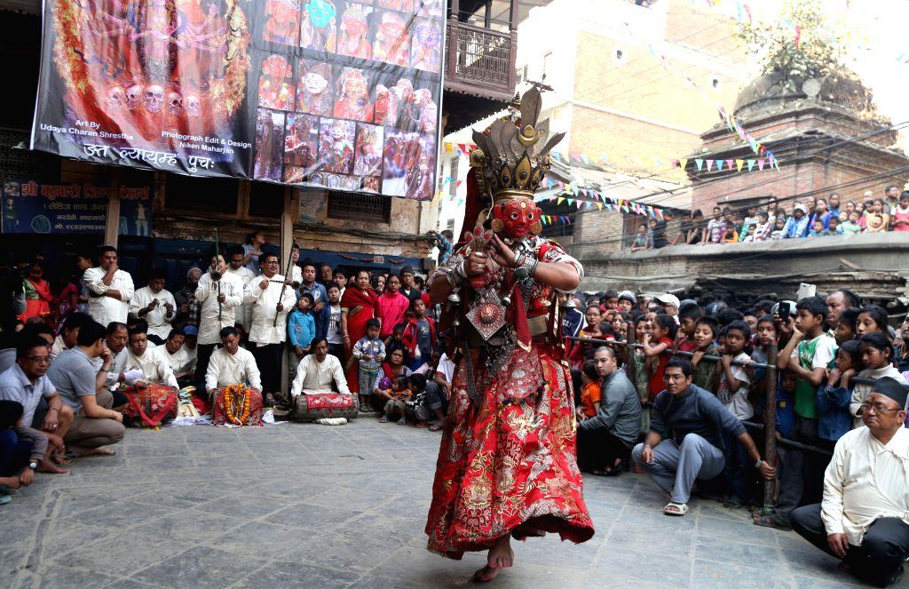 "KATHMANDU, April 7, 2016 - A masked dancer dressed up as deity performs ""Devi Pyankha"" (Devi Dance in local language) to mark the Ghode Jatra (horse racing festival) in Kathmandu, Nepal, ..."