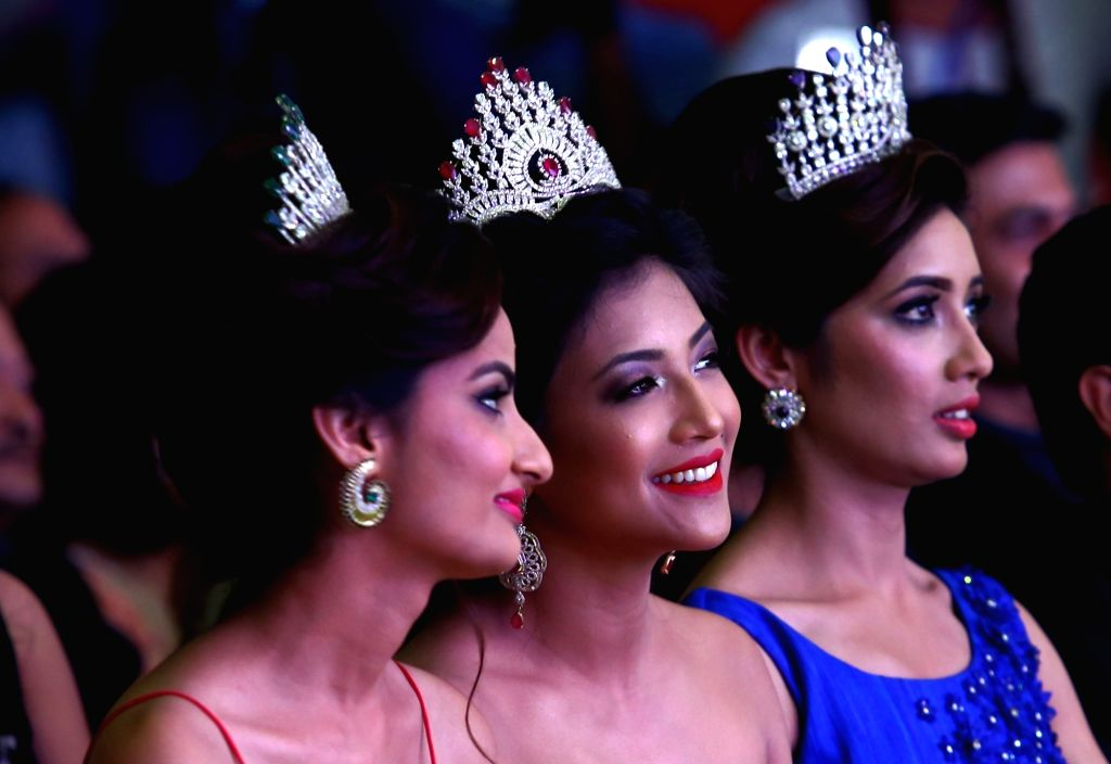 KATHMANDU, April 9, 2016 - Miss Nepal 2015 Evana Manandhar (C) watches the grand finale Miss Nepal 2016 beauty pageant in Kathmandu, capital of Nepal, on April 8, 2016. Nineteen participants competed ...