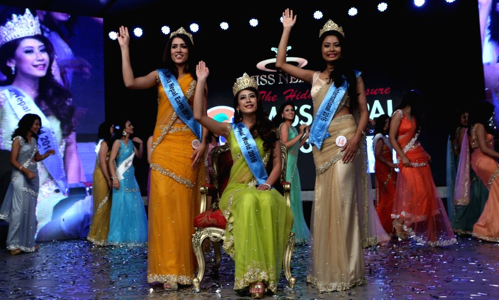 KATHMANDU, April 9, 2016 - Winner of Miss Nepal 2016 Asmi Shrestha (front C), first runner-up Roshani Khatri (front L) and second runner-up Barsha Lekhi (front R) wave to the audience in the grand ...