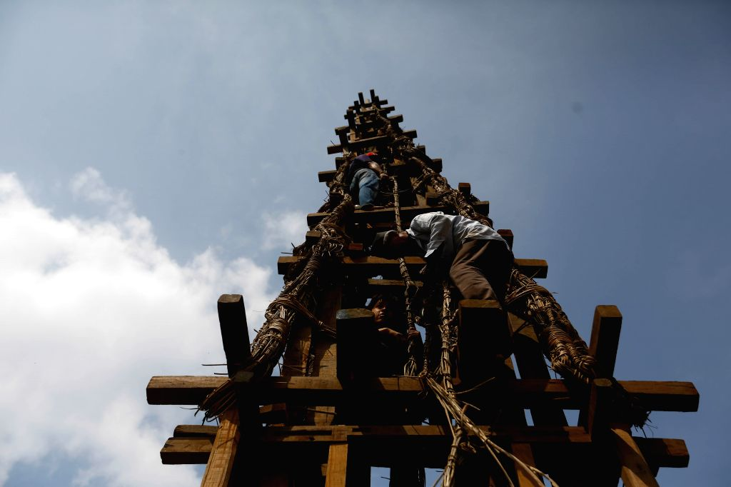 KATHMANDU, April 9, 2019 - People prepare the chariot for the upcoming Seto Machhendranath festival in Kathmandu, Nepal, on April 9, 2019. Seto Machhendranath, also known as God of Rain, is a deity ...