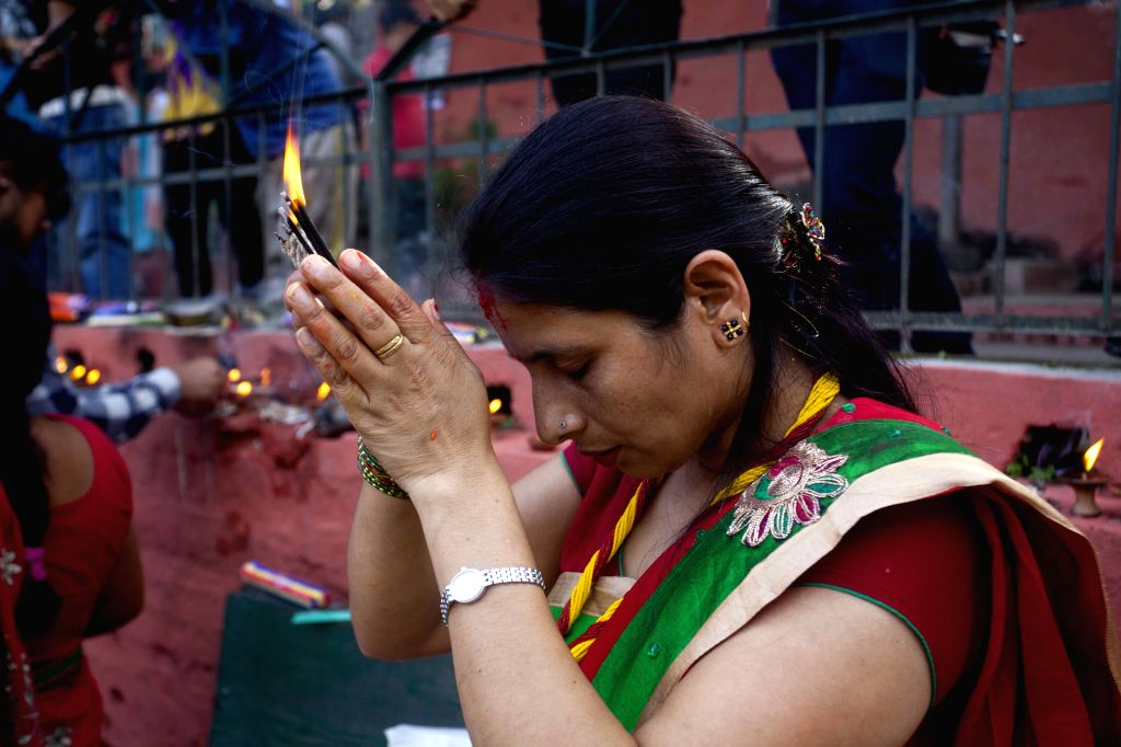 A devotee prays during Nag Panchami, the snake day festival in Kathmandu, Nepal, on August 1, 2014. The Hindu festival Nag-Panchami is celebrated by Hindu devotees