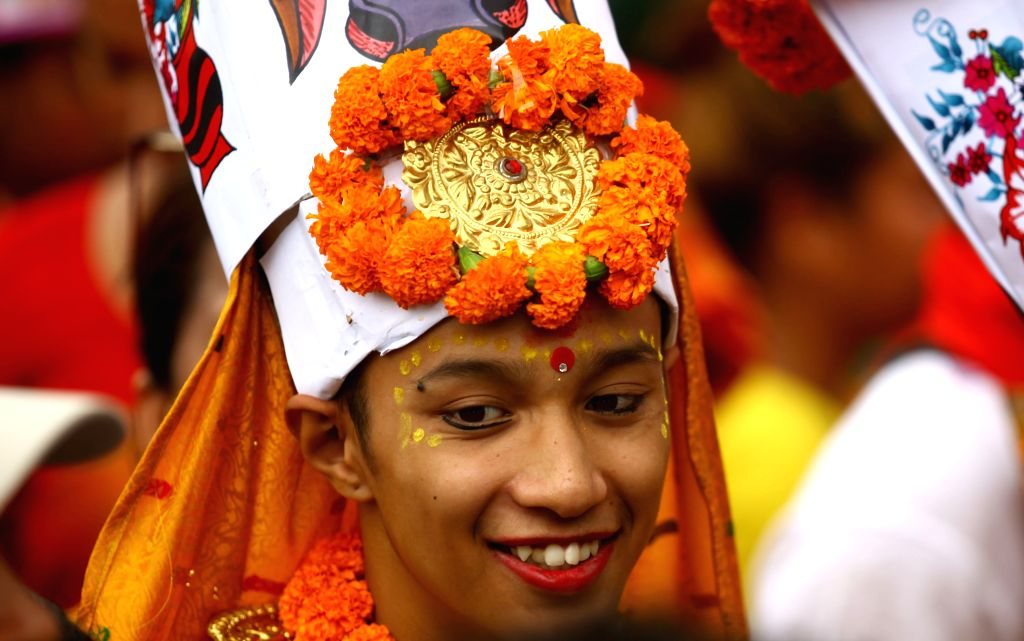 KATHMANDU, Aug. 16, 2019 - A boy smiles as he participates in a procession during the Gaijatra festival, or festival of cows, in Kathmandu, Nepal, Aug. 16, 2019. Hindus celebrate the festival to ...