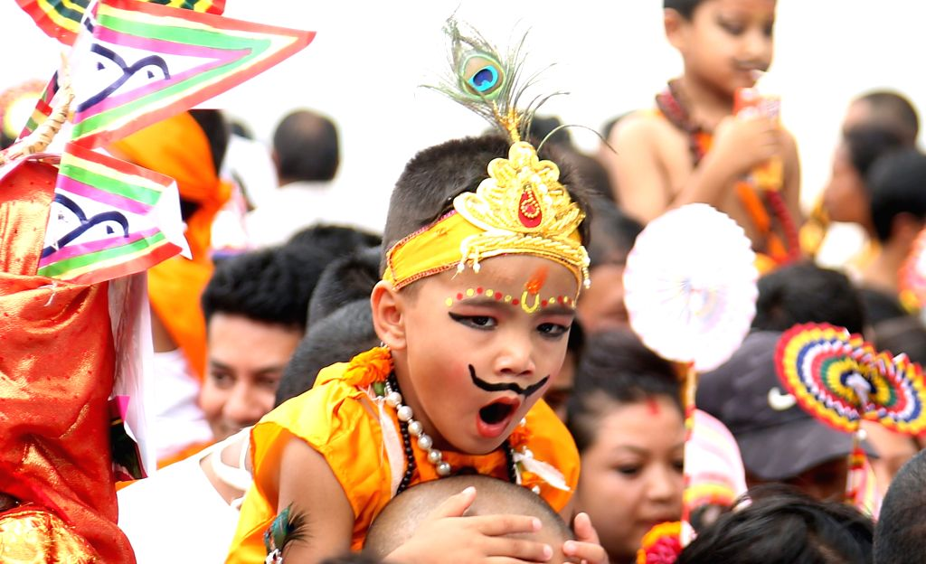 KATHMANDU, Aug. 16, 2019 - A kid dressed up as Lord Krishna yawns as he participates in a procession during the Gaijatra festival, or festival of cows, in Kathmandu, Nepal, Aug. 16, 2019. Hindus ...