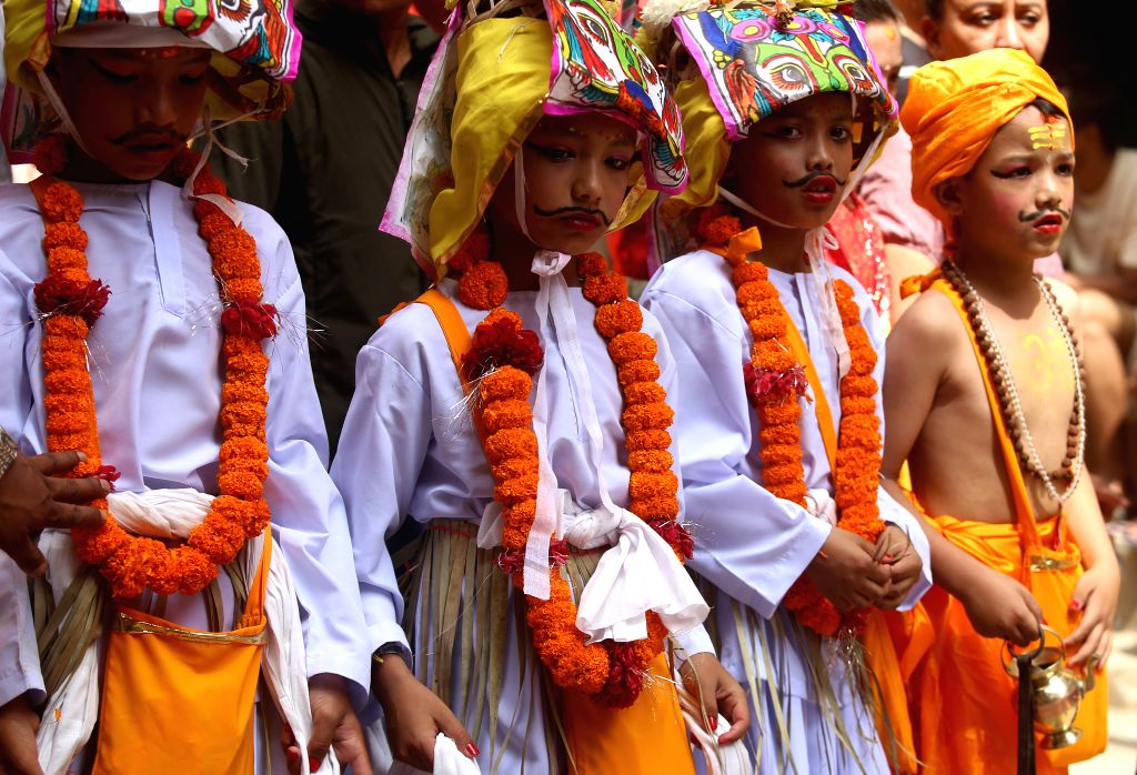 KATHMANDU, Aug. 16, 2019 - Kids participate in a procession during the Gaijatra festival, or festival of cows, in Kathmandu, Nepal, Aug. 16, 2019. Hindus celebrate the festival to honor cows, and ...