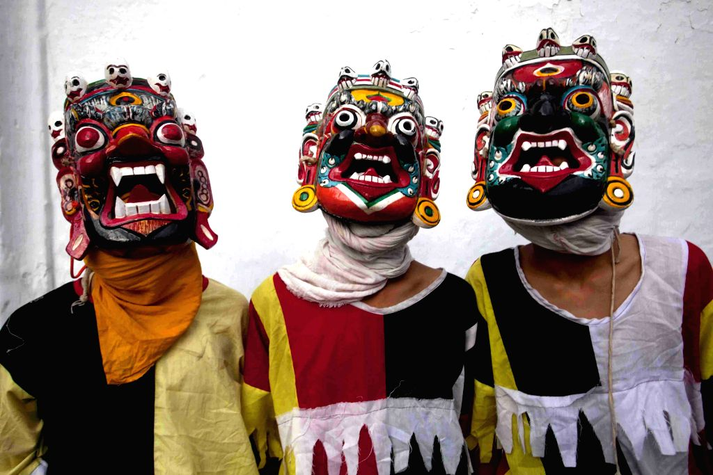 Newaris in traditional costume wear masks of Lakhey ahead of Janmashtami festival at Basantapur in Kathmandu, Nepal, Aug. 16, 2014. The festival, which will take .