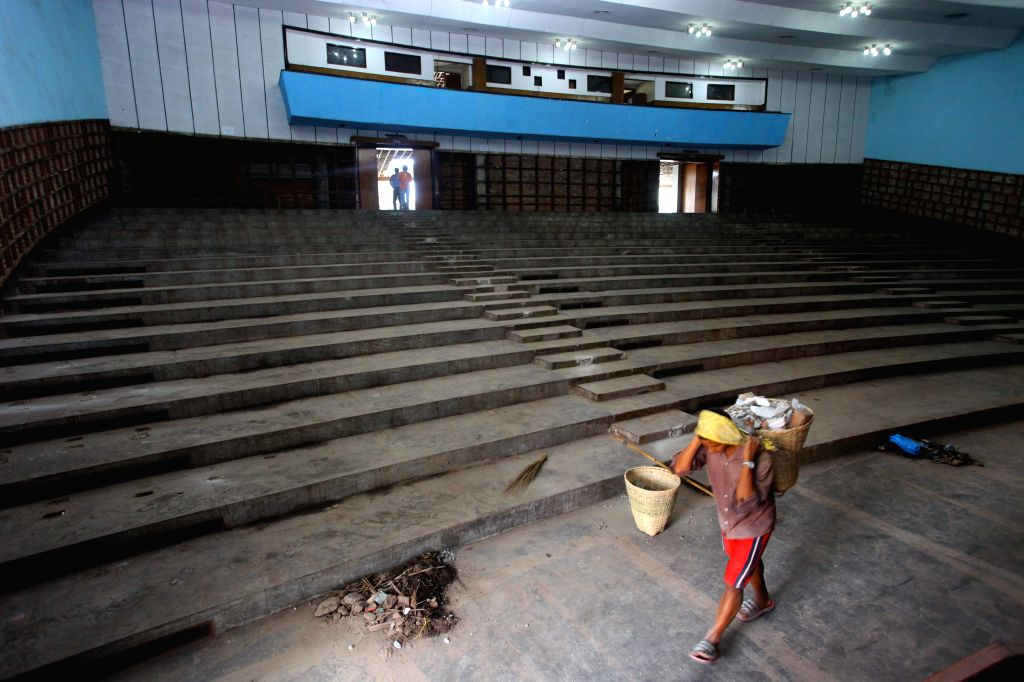 A worker works at an auditorium for the upcoming South Asian Association for Regional Cooperation (SAARC) in Kathmandu, Nepal, Aug. 19, 2014. The Nepal government