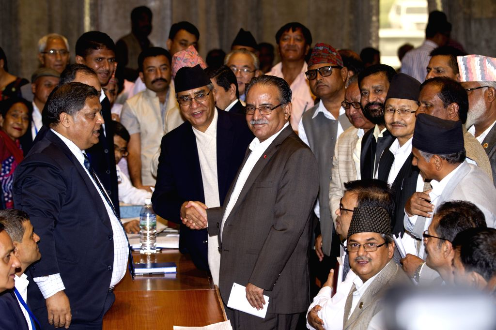 KATHMANDU, Aug. 2, 2016 - Nepal's Chairman of CPN Maoist-Centre Pushpa Kamal Dahal (C) shakes hands with Nepalese Congress President Sher Bahadur Deuba after registering his candidacy for the post of ...