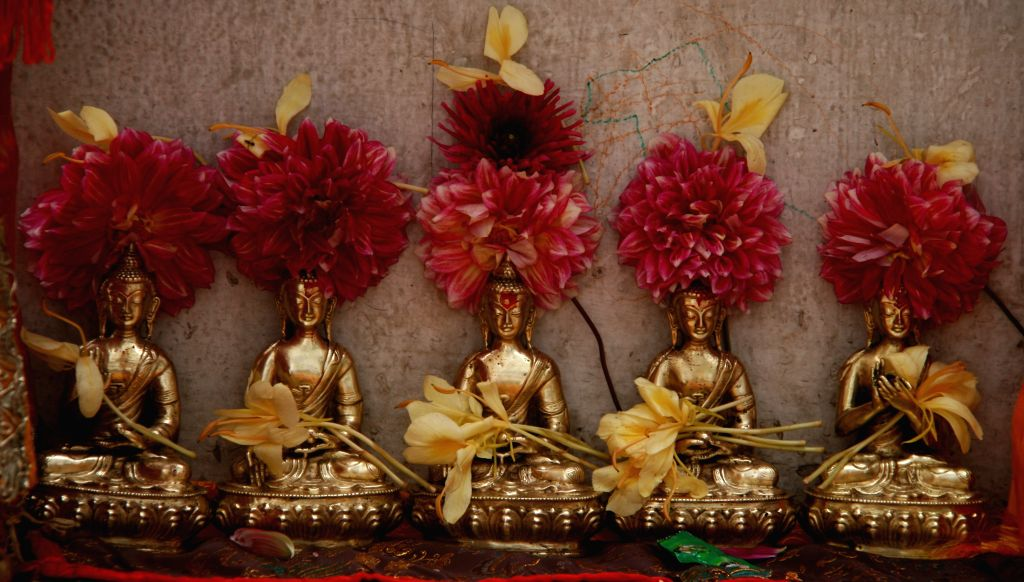 Idols of Buddha for offerings are displayed during the Pancha Dan festival in Kathmandu, Nepal, Aug. 23, 2014. Pancha Dan, the festival of five summer gifts, is ..