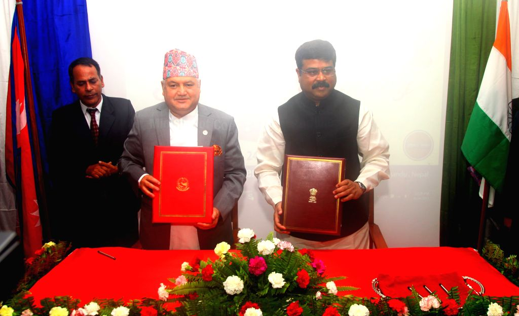 KATHMANDU, Aug. 24, 2015 (Xinhua) -- India's Oil Minister Dharmendra Pradhan (R) and Nepal's Minister of Commerce and Supplies Sunil Bahadur Thapa (C) show the signed documents during a signing ceremony of a Memorandum of Understanding (MoU) of pipel - Dharmendra Pradhan and Sunil Sharma