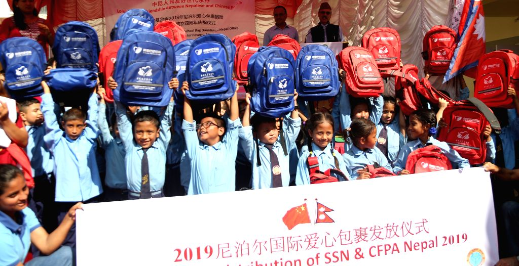 KATHMANDU, Aug. 27, 2019 - Students pose with bags distributed by China Foundation for Poverty Alleviation (CFPA) during a ceremony in Kathmandu, Nepal, on Aug. 27, 2019. Over 300 deaf students in ...