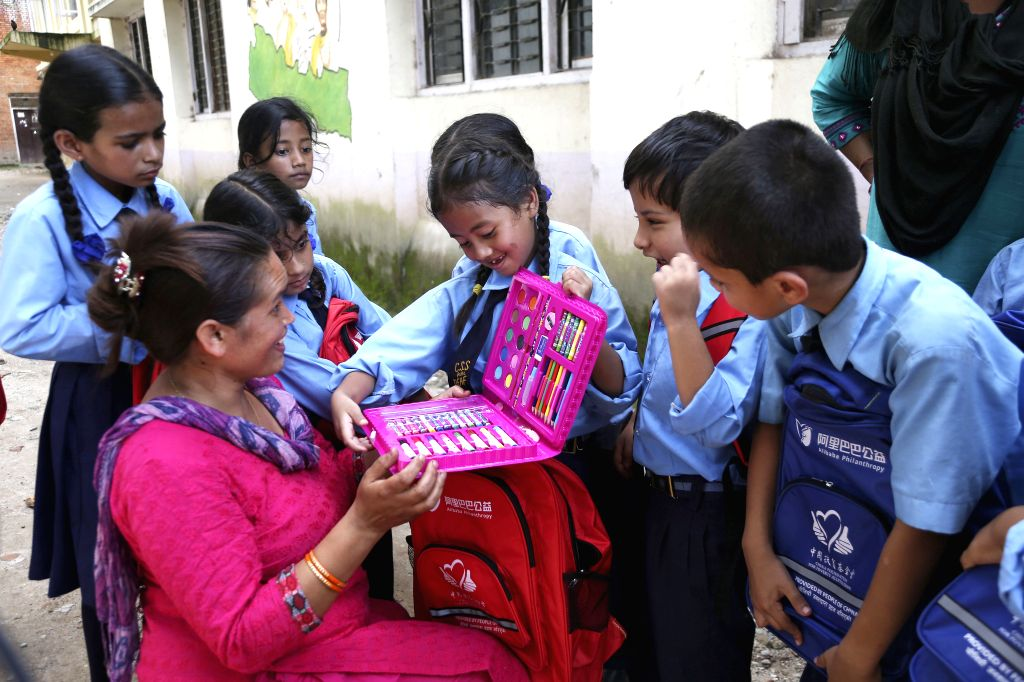 KATHMANDU, Aug. 27, 2019 - Students receive bags and stationery items from China Foundation for Poverty Alleviation (CFPA) in Kathmandu, Nepal, on Aug. 27, 2019. Over 300 deaf students in Nepal have ...