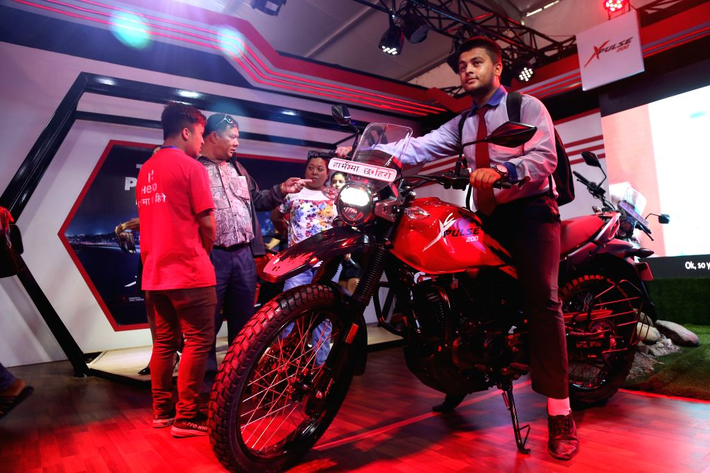 KATHMANDU, Aug. 29, 2019 - A visitor tries a motorcycle at the Nepal Automobile Dealers' Association (NADA) Auto Show 2019 in Kathmandu, capital of Nepal, Aug. 28, 2019. The 14th edition of NADA Auto ...