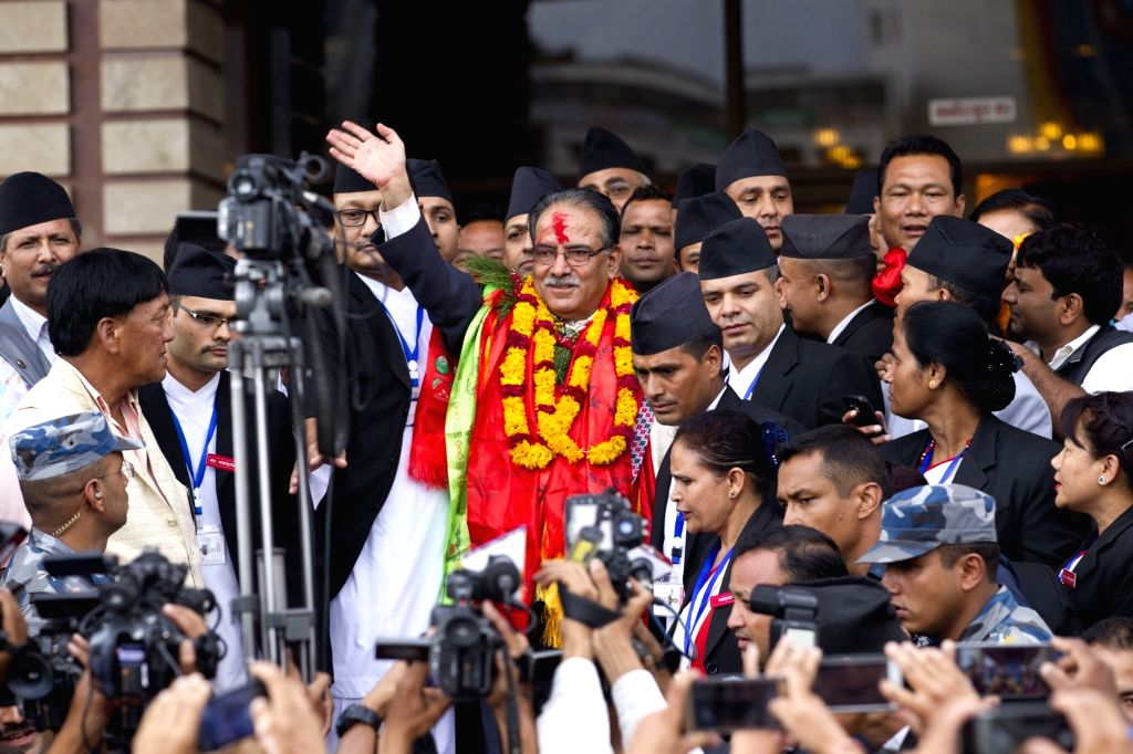 KATHMANDU, Aug. 3, 2016 - Nepal's newly elected Prime Minister Puspa Kamal Dahal (C) waves after winning the election in Kathmandu, Nepal, Aug. 3, 2016. CPN (Maoist Center) Chairman Pushpa Kamal ... - Puspa Kamal Dahal