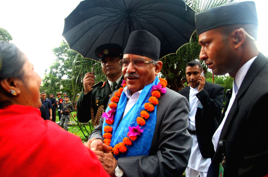 KATHMANDU, Aug. 4, 2016 - Nepal's newly elected Prime Minister Pushpa Kamal Dahal (C) talks with a local woman during his visit to Martyrs' Memorial park at Lainchaur, Kathmandu, Nepal, Aug. 4, 2016. ... - Pushpa Kamal Dahal and Sunil Sharma