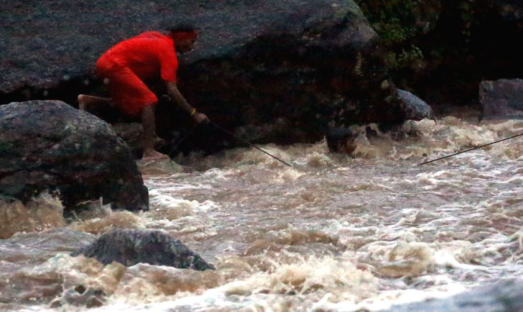 KATHMANDU, Aug. 6, 2018 - A man rescues a drowning man during the Bol Bom pilgrimage at Sudarijal, Katmandu, Nepal, Aug. 6, 2018.