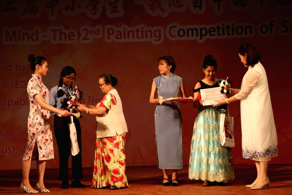 KATHMANDU, Aug. 8, 2019 - Nepal's Minister of Women, Children and Senior Citizen Tham Maya Thapa (3rd L) and Chinese Ambassador to Nepal Hou Yanqi (1st R) present prizes to two winners during the ...