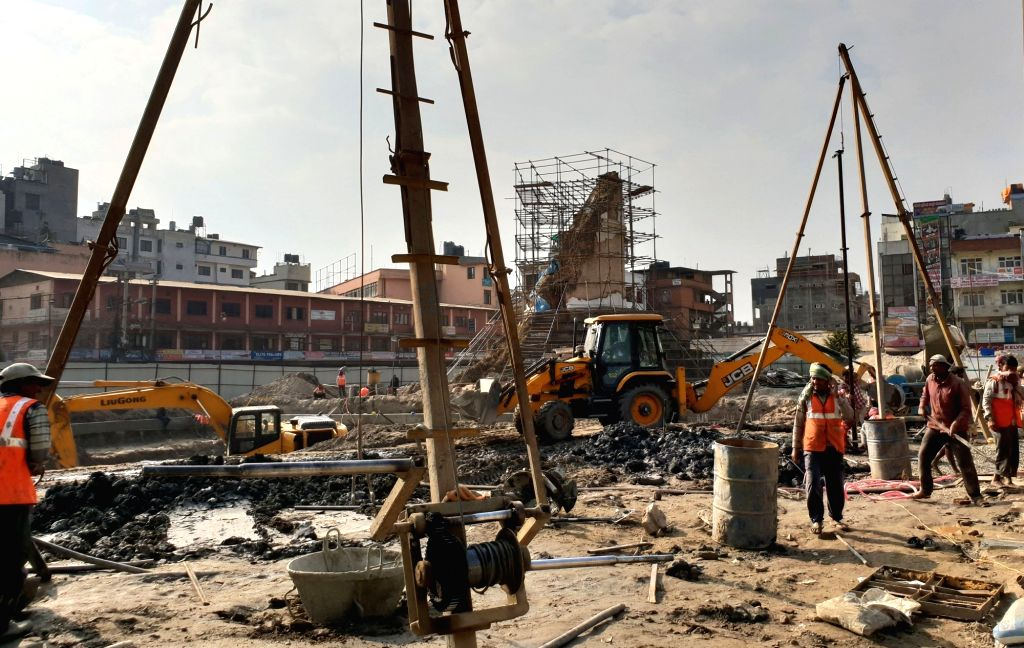 KATHMANDU, Dec. 10, 2018 - People work at the reconstruction site of Dharahara, or Bhimsen Tower, in Kathmandu, Nepal, Dec. 10, 2018. The reconstruction of landmark nine-storey Dharahara, which was ...