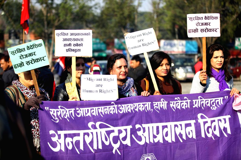 Nepalese people participate in a rally to mark the International Migrants day in Kathmandu, Nepal, Dec. 18, 2014. International Migrants Day is observed annually .