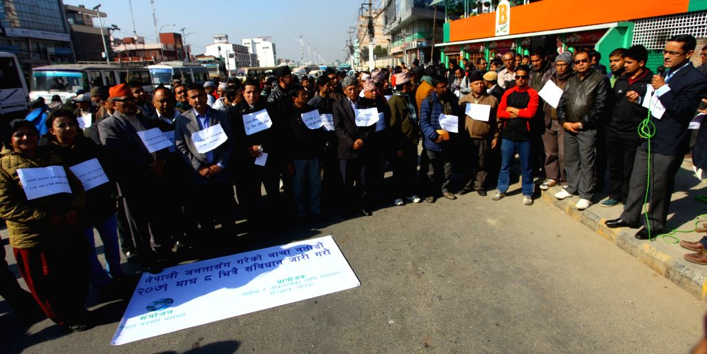 Representatives of various professional organisations attend a sit-in protest program demanding timely promulgation of a new constitution in front of the ...