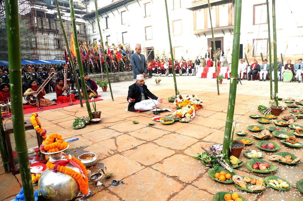 KATHMANDU, Feb. 10, 2019 - A priest chants religious hymns during a program organized on the occasion of Basanta Panchami or Shree Panchami Festival at Hanumandhoka Durbar Square in Kathmandu, Nepal, ...