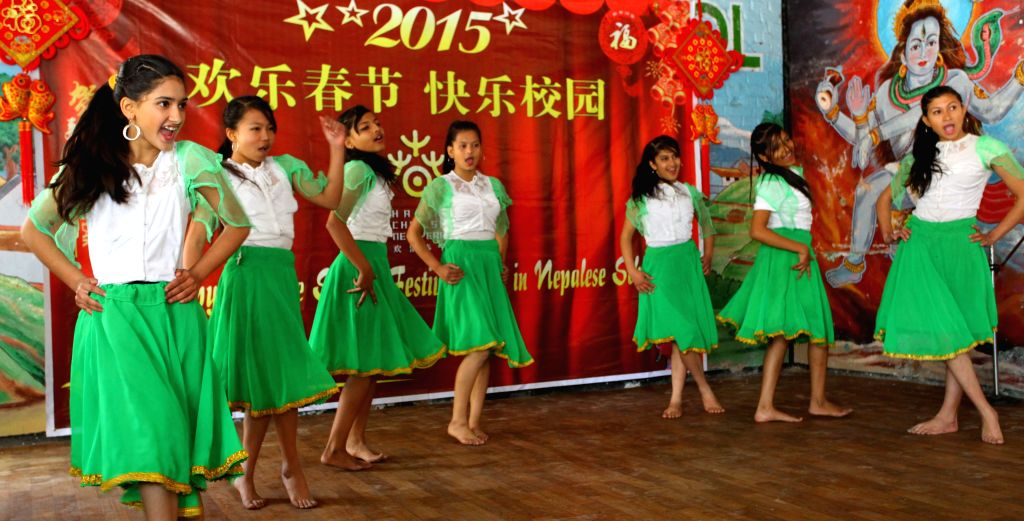 Nepalese students perform a Chinese song during the celebration of Chinese spring festival in Kathmandu, Nepal, Feb. 12, 2015.
