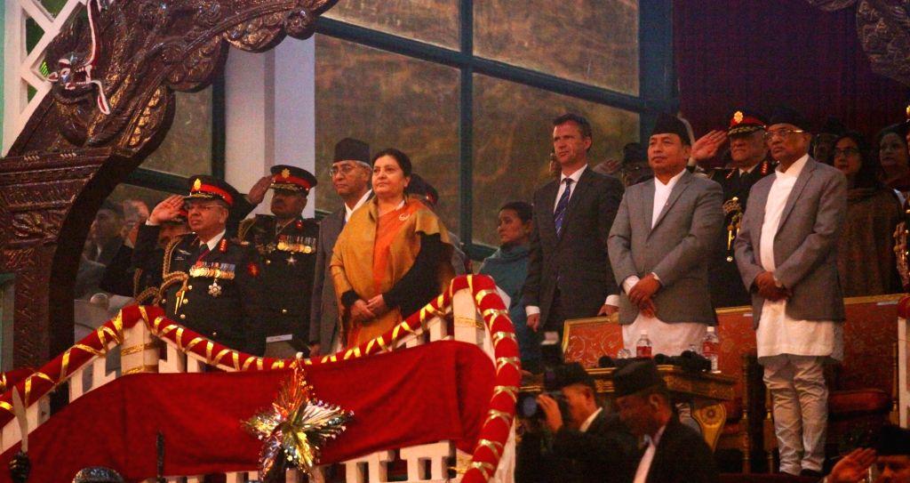 KATHMANDU, Feb. 13, 2018 - Nepalese President Bidhya Devi Bhandari (C) receives the guard of honor during the Army Day celebration at Tundikhel in Kathmandu, Nepal, on Feb. 13, 2018. Nepalese Army ...