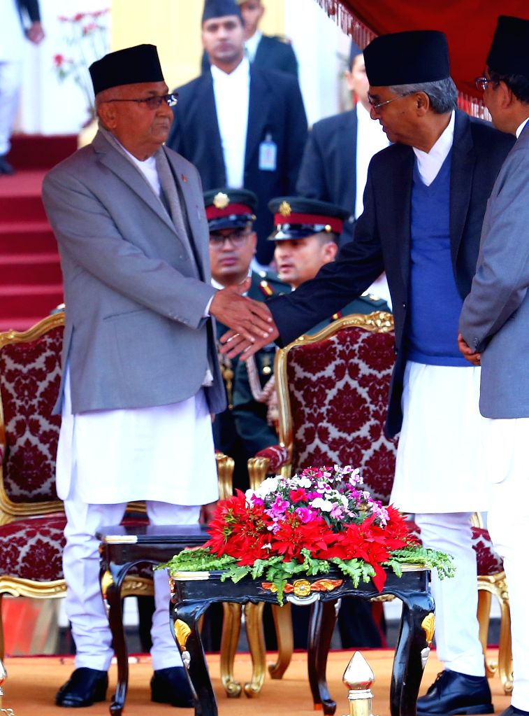 KATHMANDU, Feb. 15, 2018 - Prime Minister of Nepal KP Sharma Oli (Front L) and former Prime Minister Sher Bahadur Deuba (Front R) shake hands during the oath ceremony at the President's office in ... - Sher Bahadur Deuba