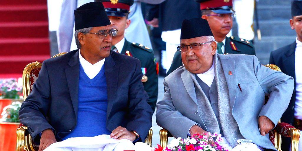 KATHMANDU, Feb. 15, 2018 - Prime Minister of Nepal KP Sharma Oli (Front R) and former Prime Minister Sher Bahadur Deuba (Front L) attend the oath ceremony at the President's office in Kathmandu, ... - Sher Bahadur Deuba