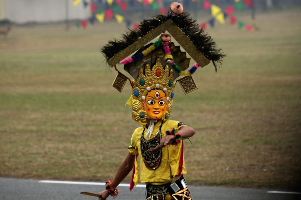 KATHMANDU, Feb. 19, 2019 - A masked dancer performs during the National Democracy Day celebration at Tundikhel in Kathmandu, Nepal, on Feb. 19, 2019. Nepal's 69th National Democracy Day was observed ...