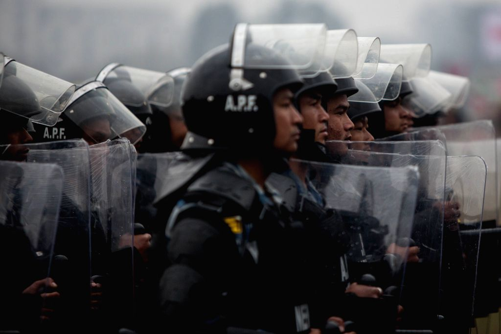 KATHMANDU, Feb. 19, 2019 - Armed Police Force personnel march in a parade during the National Democracy Day celebration at Tundikhel in Kathmandu, Nepal, Feb. 19, 2019. Nepal's 69th National ...
